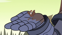S4E35 Cockerel crowing in Mina's armored hand