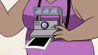 S4E27 Instant camera around old lady's neck