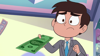 S3E34 Marco inserting the money