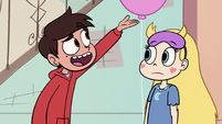 S1E6 Marco points to wall of pictures