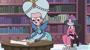 S3E28 Queen Moon examining Eclipsa's scroll