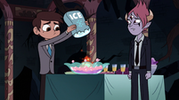 S3E24 Marco pouring ice into punch bowl