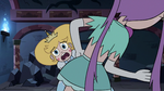 S3E24 Star Butterfly trying to see past Mina