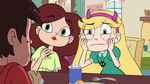 S3E32 Star and Angie looking at Marco's chin