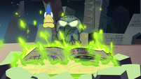 S3E3 Glossaryck hovers over the burning book of spells