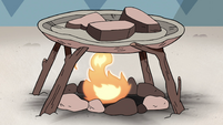 S4E8 Rocks roasting on a campfire