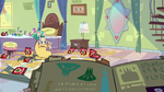 S2E25 Star Butterfly looking at her book of spells