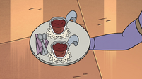 S4E36 Two chocolate pudding cups on a tray