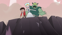 S3E7 Moon stops Marco and Buff Frog in front of crater