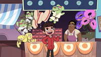S3E13 Marco Diaz pointing at a karate dog plush