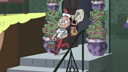 S4E1 Mewman carrying a mop and pail