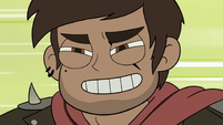 S3E22 Adult Marco Diaz riding with a grin