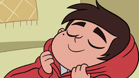 S3E8 Marco Diaz wrapped tightly in his hoodie