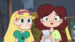 S3E32 Star and Angie looking over at Marco