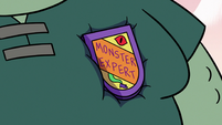 S3E17 Buff Frog wearing Dr. Goodwell's badge