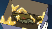 S4E10 Book of Spells piece covered in gold water