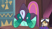 S3E29 Rhombulus covers his face with a hood