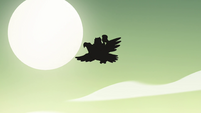 S4E34 Silhouette of eagle flying through the sky