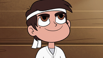 S2E37 Marco Diaz smiling up at his sensei