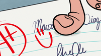 S1E3 Marco points at smiley face on his test