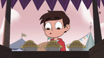 S4E1 Marco Diaz in front of a pie stand