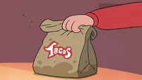 S4E26 Marco sets taco bag on the table