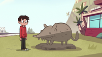 S2E38 Marco Diaz looking at Otis' statue