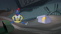 S4E23 Glossaryck laughing next to a box