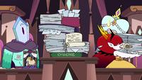 S3E29 Hekapoo picks up a pile of evidence