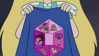 S4E18 Patches on back of Marco's new cape