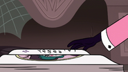 S3E28 Eclipsa turning the book page