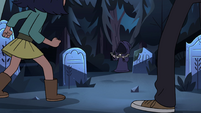 S4E19 Cloaked figure holding a bow