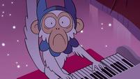 S4E9 White monkey seriously playing piano