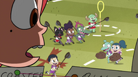S4E16 Marco sees kids playing behind the stadium