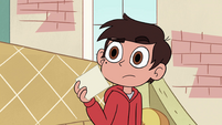 S4E27 Marco holds photo with confusion