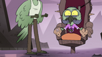 S4E14 Ludo hanging over throne cushion
