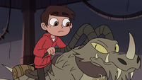 S3E22 Marco Diaz mounting his dragon-cycle