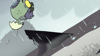 S2E2 Ludo flies over a curved-up rock