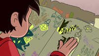 S1E11 Marco looking through the spell book