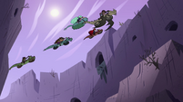 S4E22 Riders Club flying over a gorge