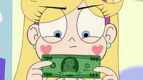 S3E34 Star holding a 100 dollar bill