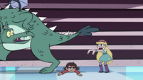S3E15 Star Butterfly shooing the dragon away