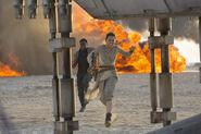 Rey & Finn Running into the Falcon