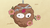 S2E9 Pinecone with drawn and flowers face on it