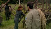 Carson and Teyla evacuate