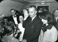 Lyndon B Johnson taking the oath of office