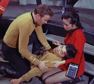 Kirk and Takayama tend to Sulu