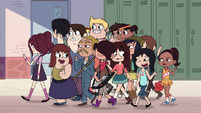 S1E3 Crowd of students pass Marco and Star