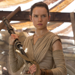 Rey holds her quarterstaff