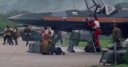 Poe dismounts X-Wing
